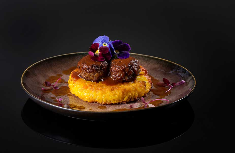 Pan fried Milanese saffron risotto with potted Ossobuco
